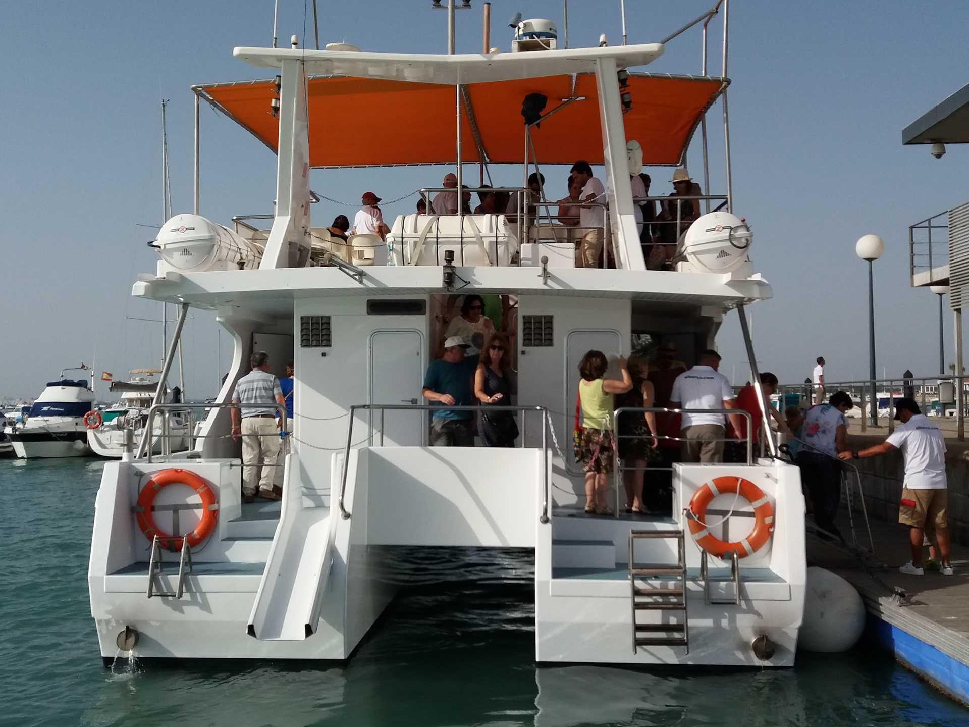 Puesta de sol en catamarán albarco.com para niños.